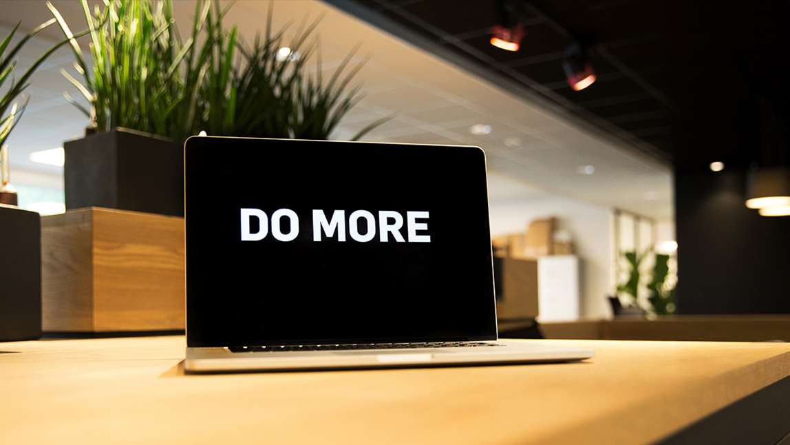 "Computer screen with the text ""Do more"" written on it. Photo."